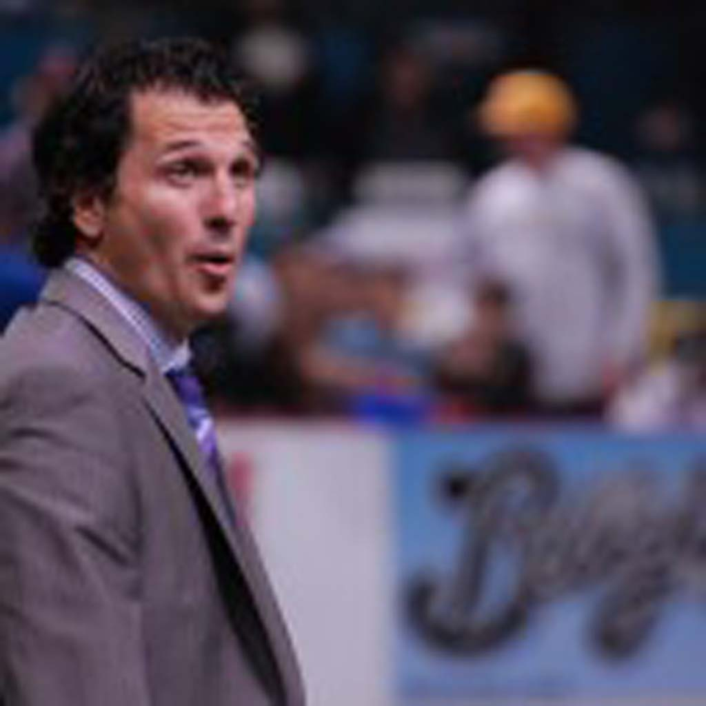 Head coach Phil Salvagio surveys the crowd during a break in the action. Photo by Tony Cagala