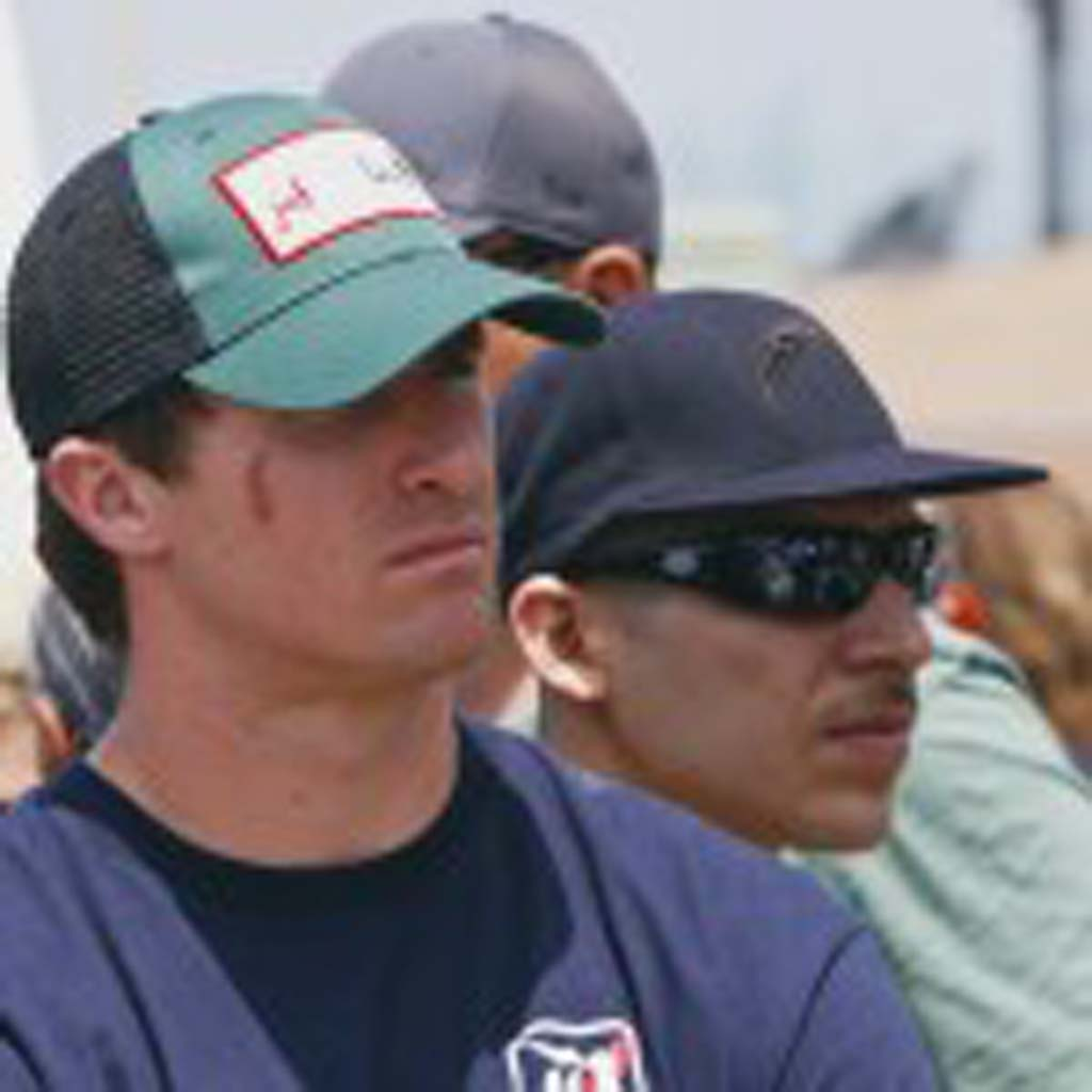 Former San Diego Chargers quarterback Drew Brees (left) visits the memorial to Junior Seau in Oceanside. Photo by BIll Reilly