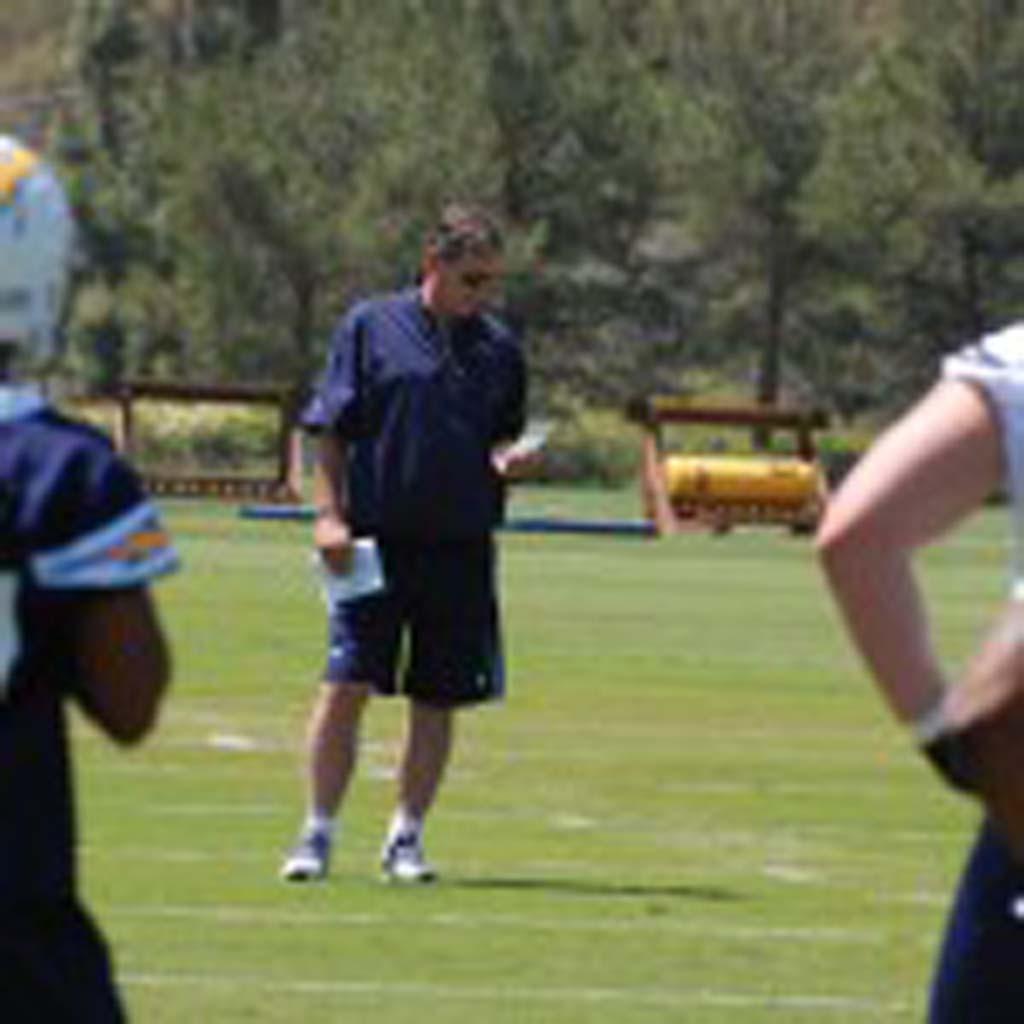 Chargers head coach Norv Turner looks over his roster of young players during rookie orientation. Photo by Tony Cagala