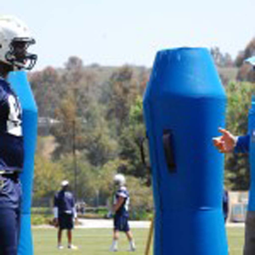 Second-round draft pick Kendall Reyes receives instruction from defensive line coach Don Johnson. Photo by Tony Cagala
