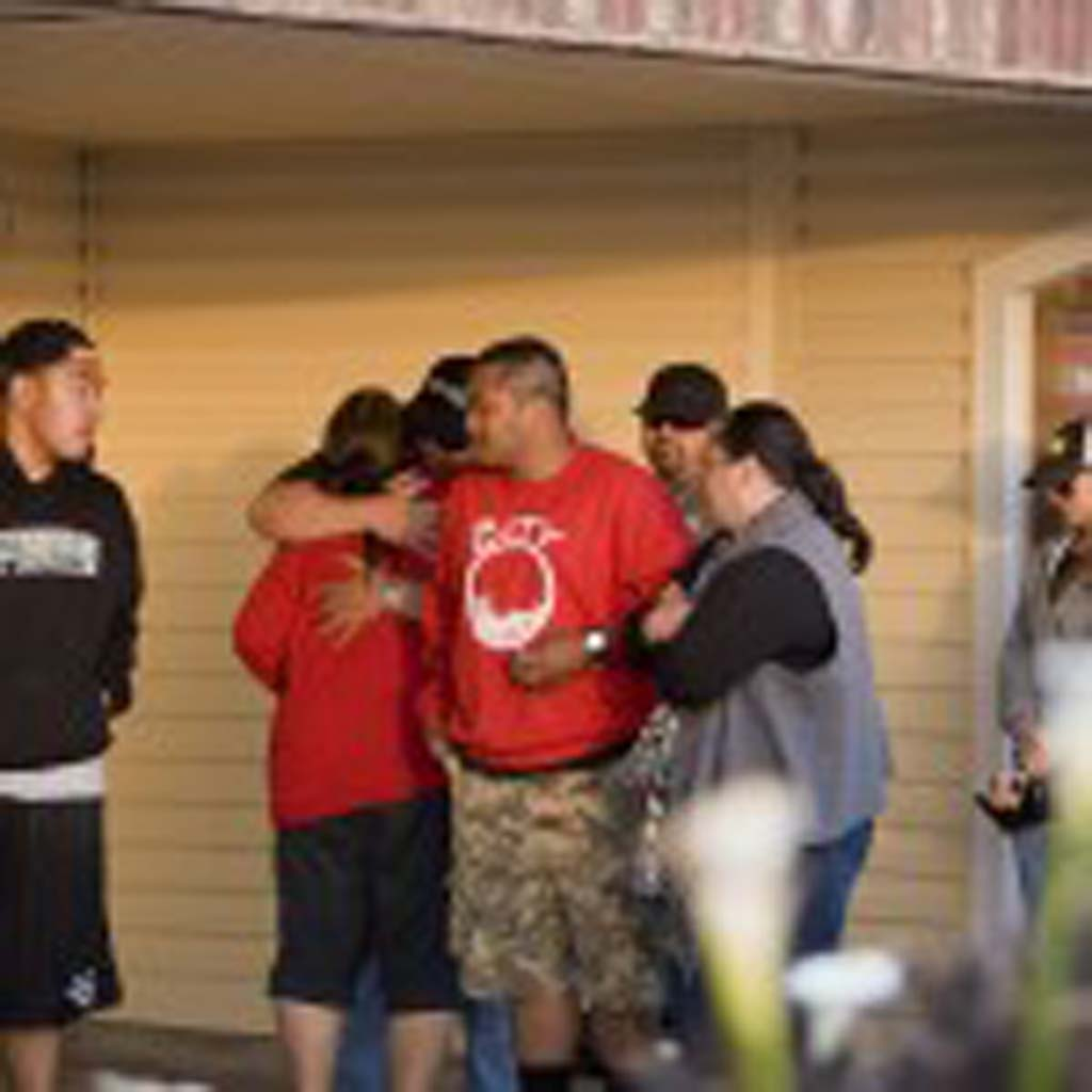 Family members gather outside the beachfront home of former San Diego Chargers all-pro linebacker Junior Seau, who was found dead at his Oceanside home of an apparent self-inflicted gunshot wound May 2.  Photo by Daniel Knighton