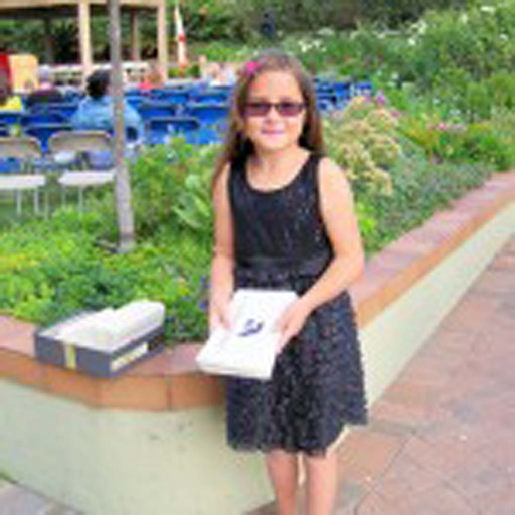 A shoeless Abi Sherer hands out programs when guests enter the Rancho Santa Fe Garden Club where the 2012 graduation was held. Photo by Patty McCormac