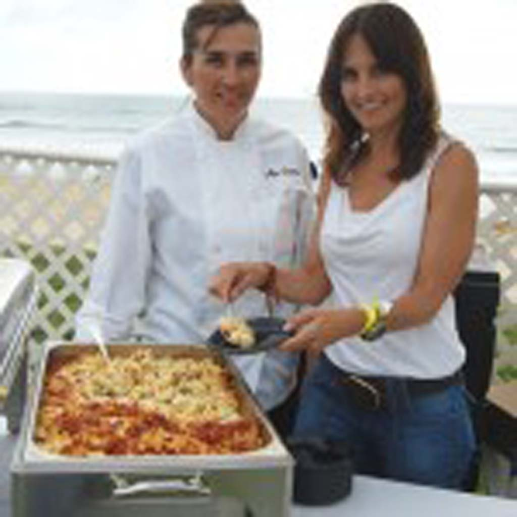 Alex Boswell (left) and Jennifer Powers serve crispy prosciutto macaroni and cheese from Zel's Del Mar. Photo by Bianca Kaplanek