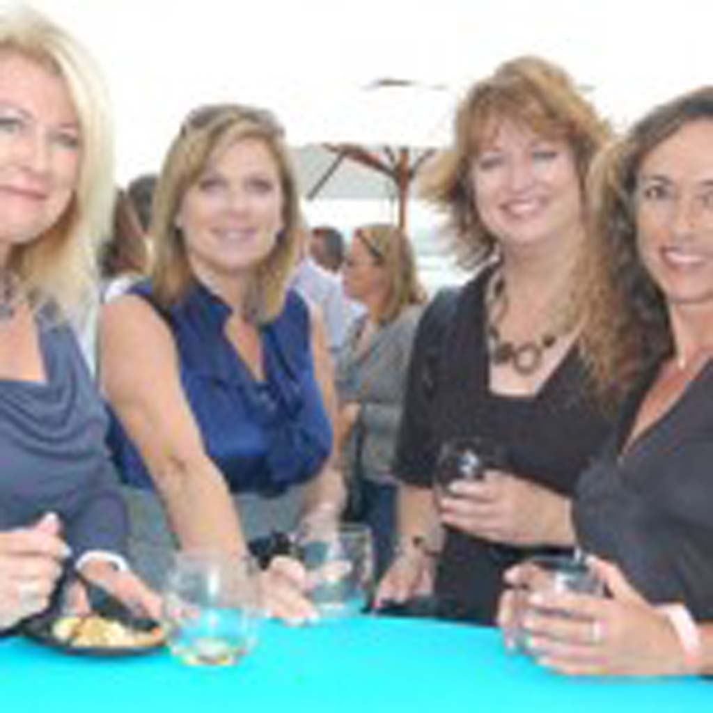 Tasting the various wines and sampling the crispy prosciutto macaroni and cheese from Zel's Del Mar are, from left, Marian Benassi, Kristen Boehmer, Linda Ilijevski and Mary Grieb. Photo by Bianca Kaplanek