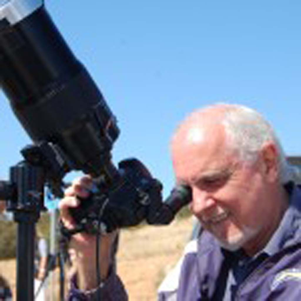 Joe Libertine of La Costa takes photos of the Venus transit through a lens he purchased more than 20 years ago and a solar filter. Photo by Tony Cagala