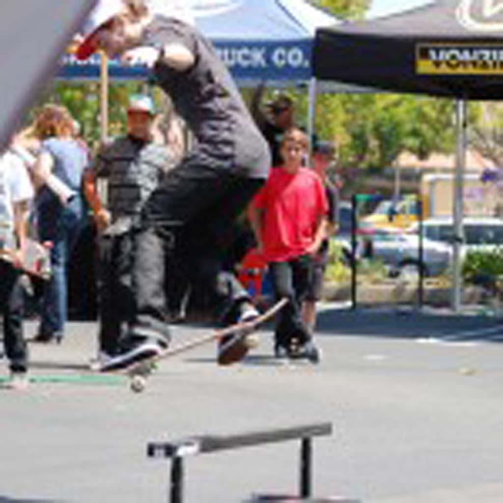 Oceanside skater Dane Vaughn attempts a trick over the rail. He won the best trick contest. Photo by Tony Cagala
