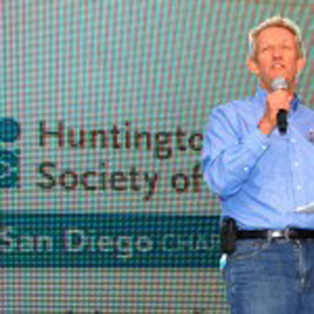 George Essig, Huntington's disease Society, San Diego chapter board president speaks to the crowd during the 11th annual Shoot to Cure HD event. Photo by Tony Cagala