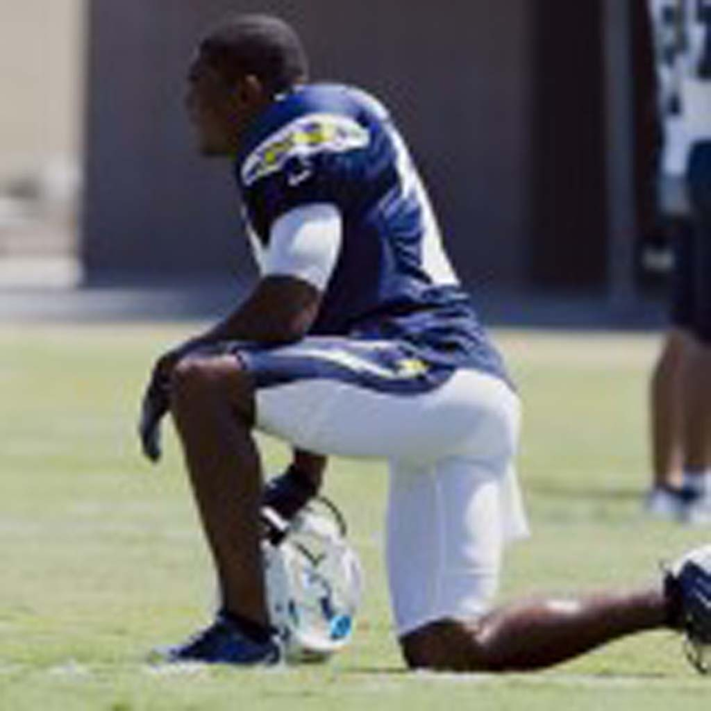 Veteran Charger corner back Quentin Jammer takes a knee during Sunday's training camp session. Photo by Bill Reilly