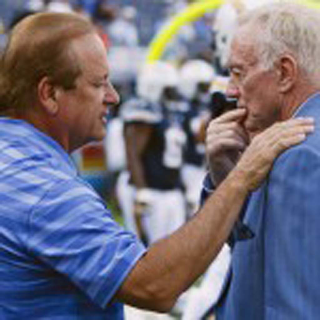 Chargers Chairman of the Board and team President Dean Spanos talks with Dalls Cowboys Owner and President Jerry Jones before the start of the game. Photo by Bill Reilly