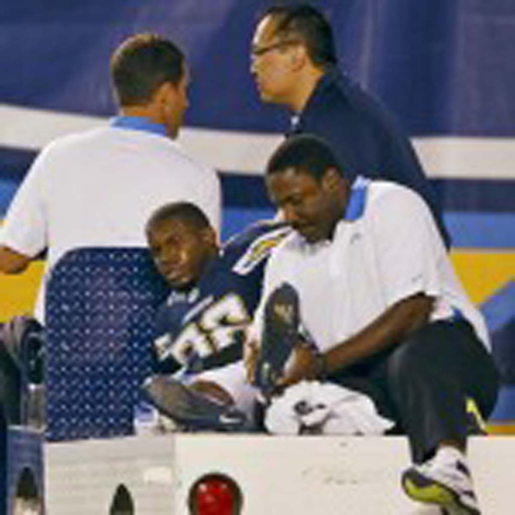 Receiver Vincent Brown is carted off the field after breaking his ankle. Photo by Bill Reilly