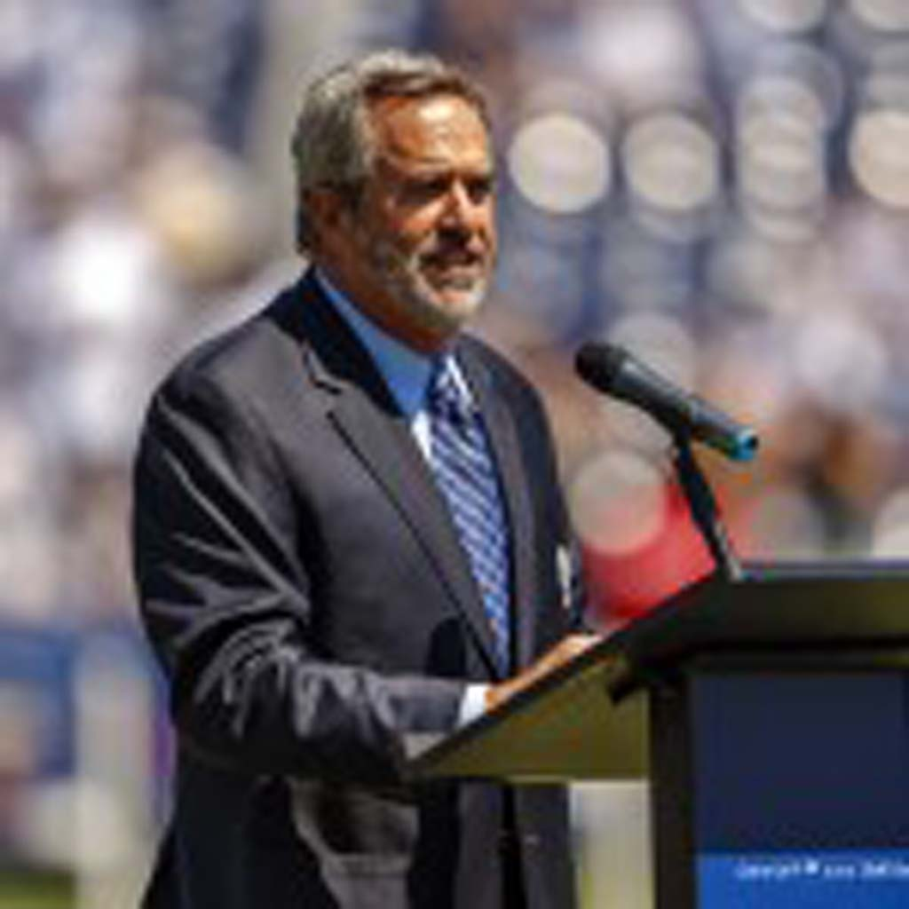Former Chargers quarterback Dan Fouts helps to retire Junior Seau's number 55 Sunday. Photo by Bill Reilly