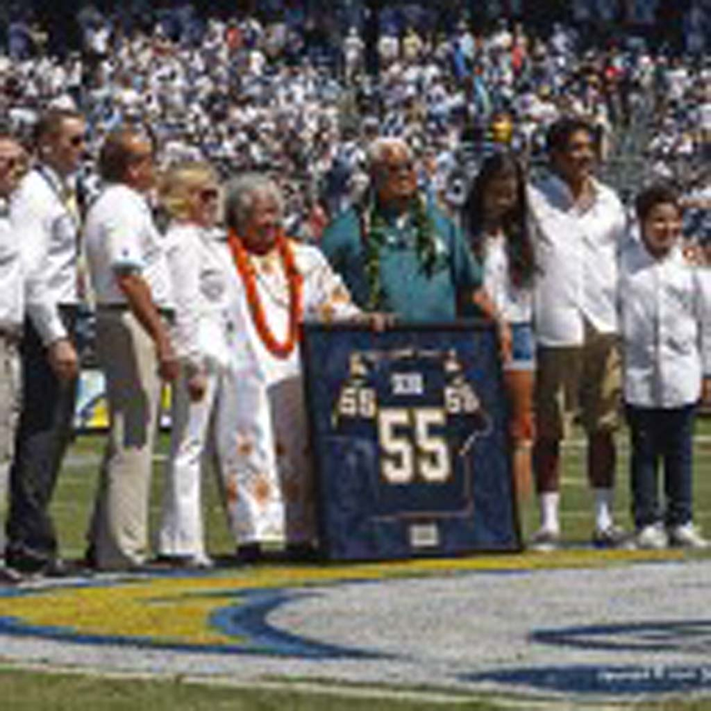 Junior Seau's parents Luisa and Tianina Seau (center) and children (from left to right) Sydney, Jake and Hunter, with the Spanos family are on hand for the ceremony retiring Seau's number 55. Photo by Bill Reilly