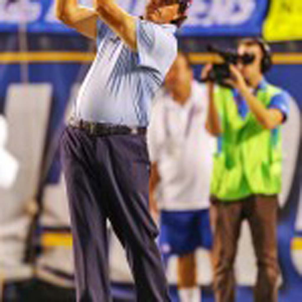 Rancho Santa Fe resident and professional golfer Phil Mickelson hits a 100-yard shot from endzone to endzone for a chance to raise $1 million for charity. Mickelson was able to raise $50,000 with his shot, which will go to the purchase of new books to children in need. Photo by Bill Reilly