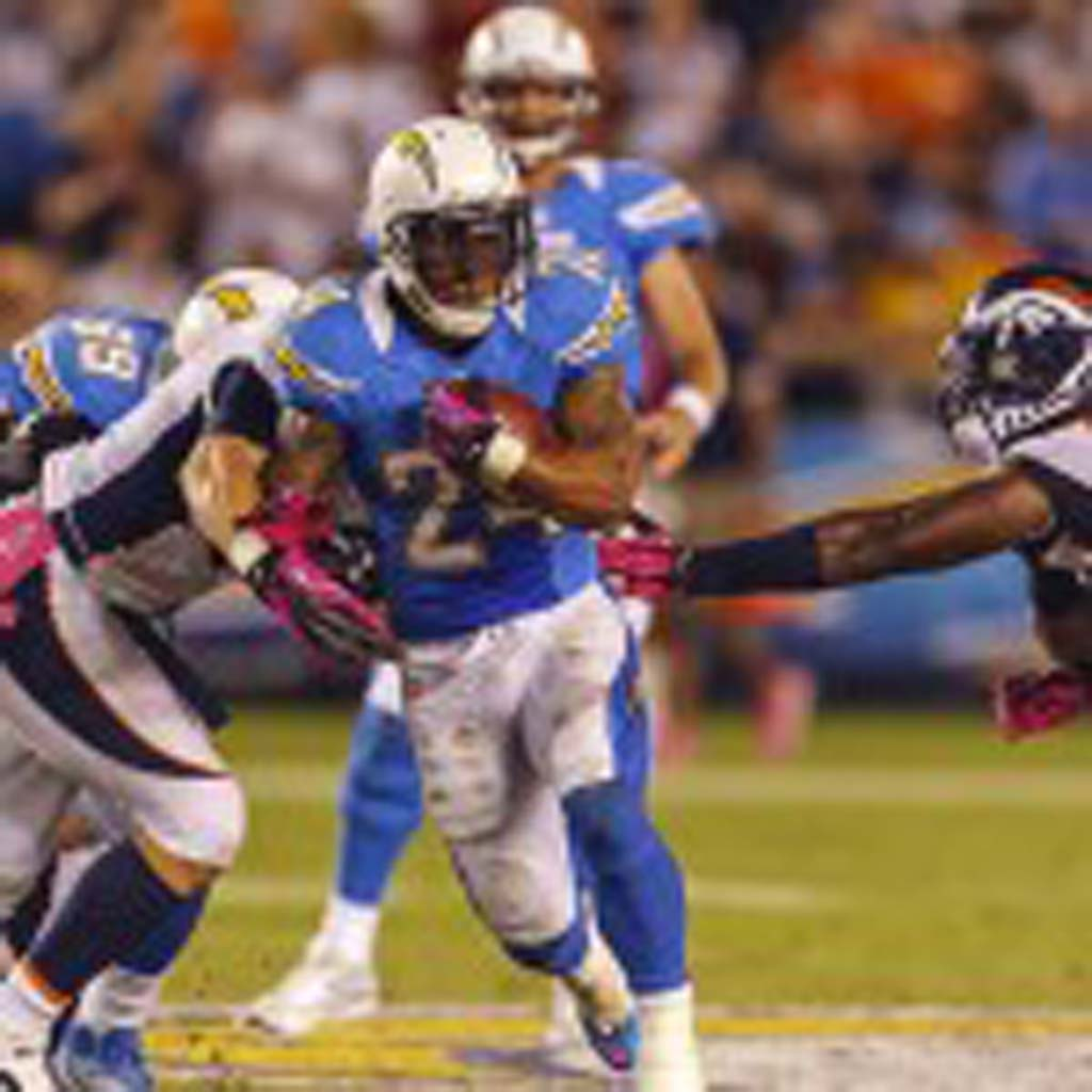 Running back Ryan Mathews carries the ball 22 times for 74 yards against the Broncos. Photo by Bill Reilly