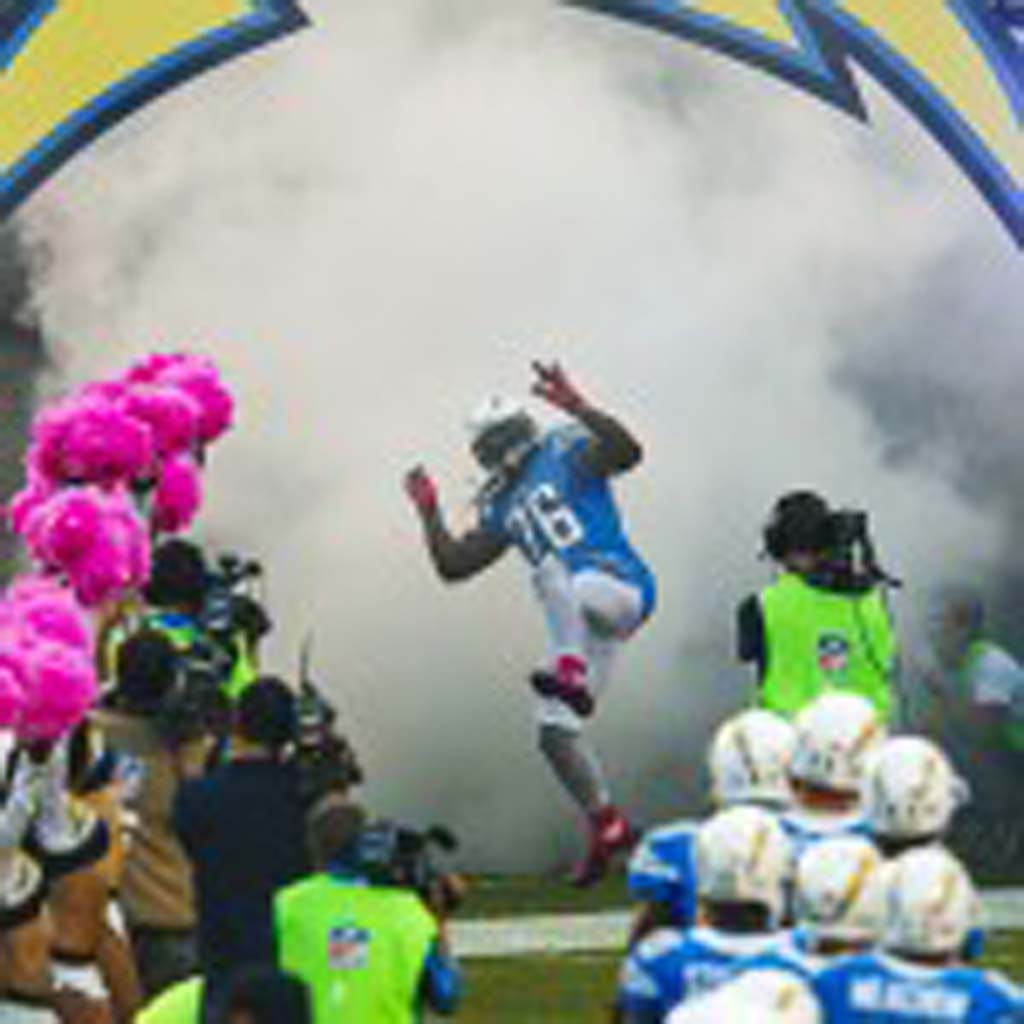 Atari Bigby emerges from the tunnel with high energy during the opening of Monday Night Football. Photo by Bill Reilly