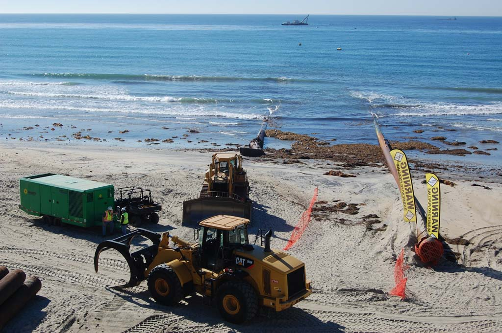 Sand replenishment resumes in Carlsbad, Solana Beach pipe still clogged
