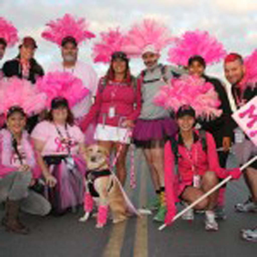 Stephanie Castle of San Diego (center) stands with her dog and team members who are walking for family members and friends diagnosed with breast cancer. The walk raises funds for breast cancer research, health programs and education programs. Photo by Promise Yee