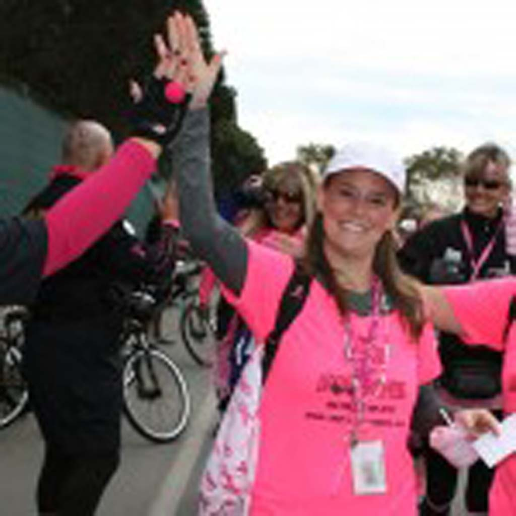 Gabrielle Xavier of San Diego gives supporters a high five as she takes off on the three-day walk. Xavier is an eight-year survivor of breast cancer. Photo by Promise Yee