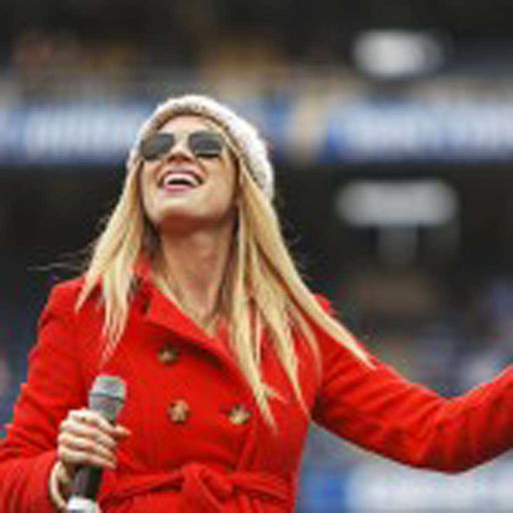 Season 7 America Idol contestant Brooke White performs Christmas songs prior to the Chargers and Panthers game Sunday at Qualcomm Stadium. Photo by Bill Reilly