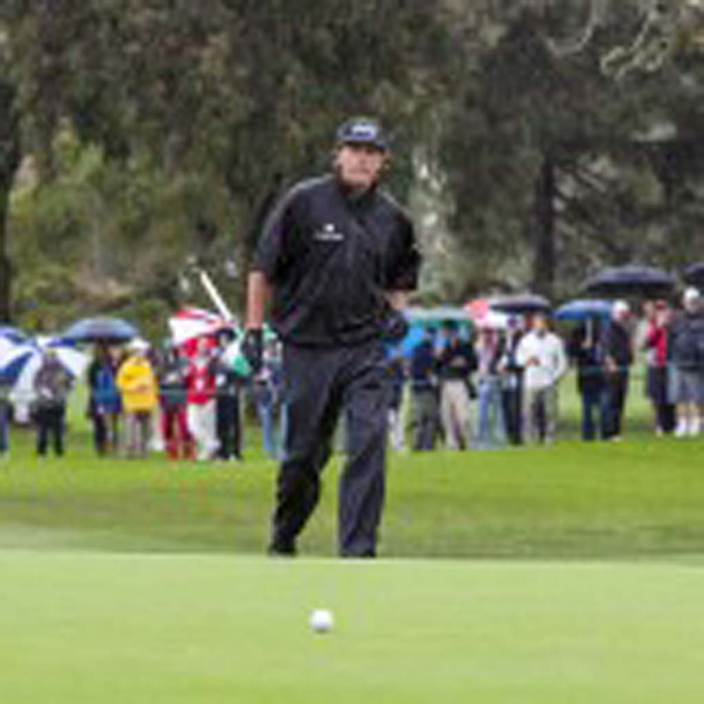 Phil Mickelson walks up to the green in the rain at Torrey Pines. He is 1-under for the tournament. Photo by Bill Reilly