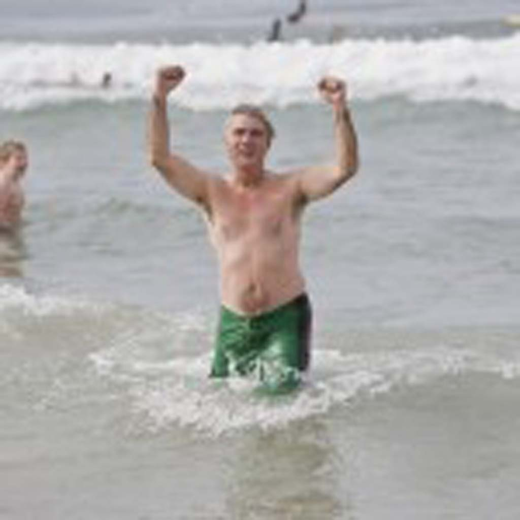 Solana Beach resident Bill Wechter comes out of the chilly water after his first Penguin Plunge.