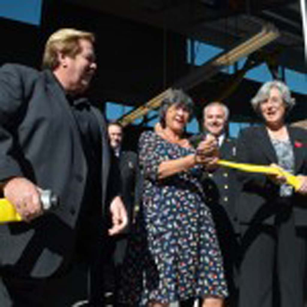 "City Council members (from left) Mark Muir, Mayor Teresa Barth, Deputy Mayor Lisa Shaffer, Tony Kranz and Kristen Gaspar (not pictured) take part in the grand opening of Fire Station No. 2 in Cardiff Friday with a ceremonial ""uncoupling"" of the hose. Photo by Tony Cagala"