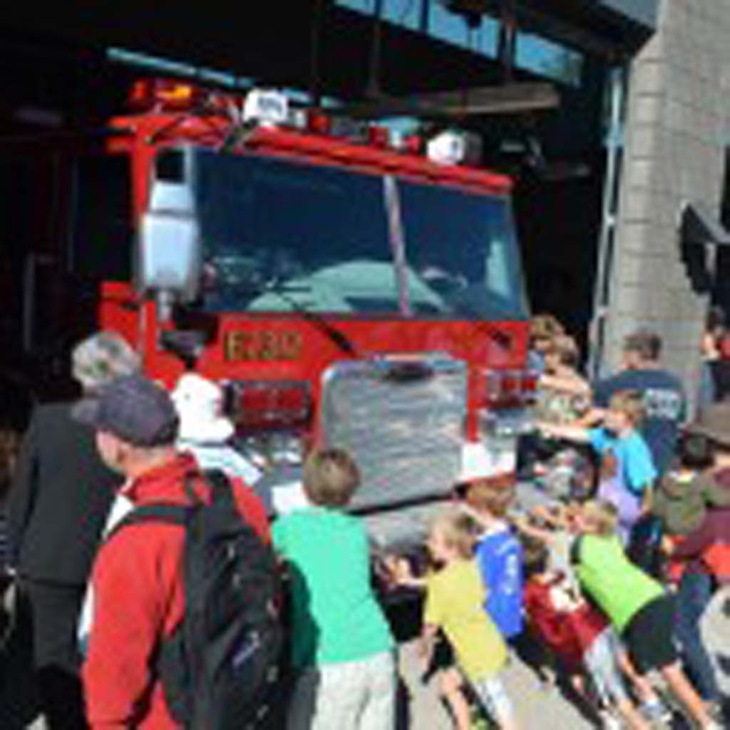 "Youngsters turn out to help ""pushing of the rig"" fire house tradition. The tradition dates back to the 19th century when horse-drawn engines had to be pushed back into the fire house. Photo by Tony Cagala"