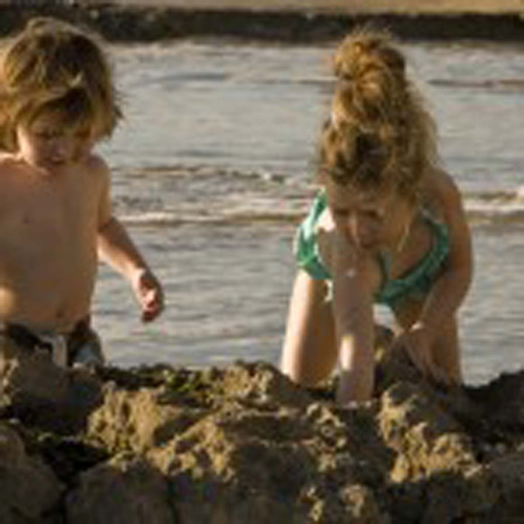 2 1/2 year old Stephen (left) and 4-year old Brooks Messrah of Carlsbad search the tide pools for sea life at Swami's. Photo by Daniel Knighton