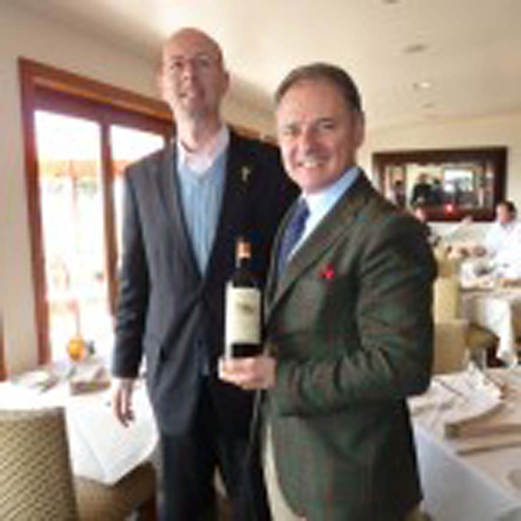 Andrea Cecchi (right) of Tuscany's leading Cecchi Wines presents a new release wine to General Manager Vittorio Homberger of Vigilucci's Restaurant in Carlsbad.   Photos by Frank Mangio