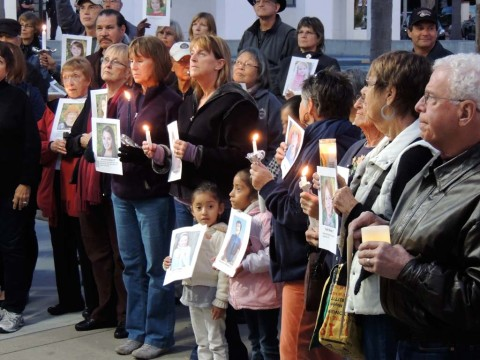 Victims of gun violence honored in candlelight vigil