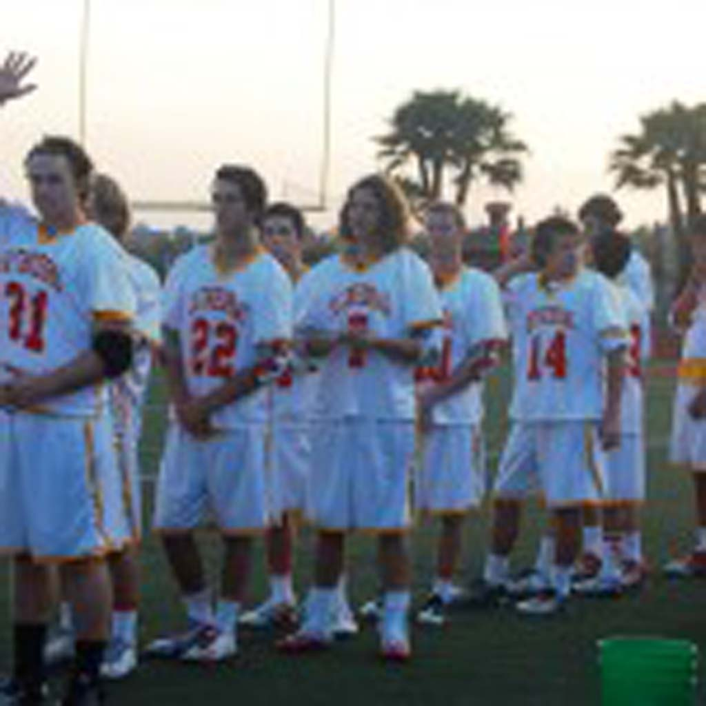 The Dons lacrosse team lines up for the pregame events. Photo by Bianca Kaplanek