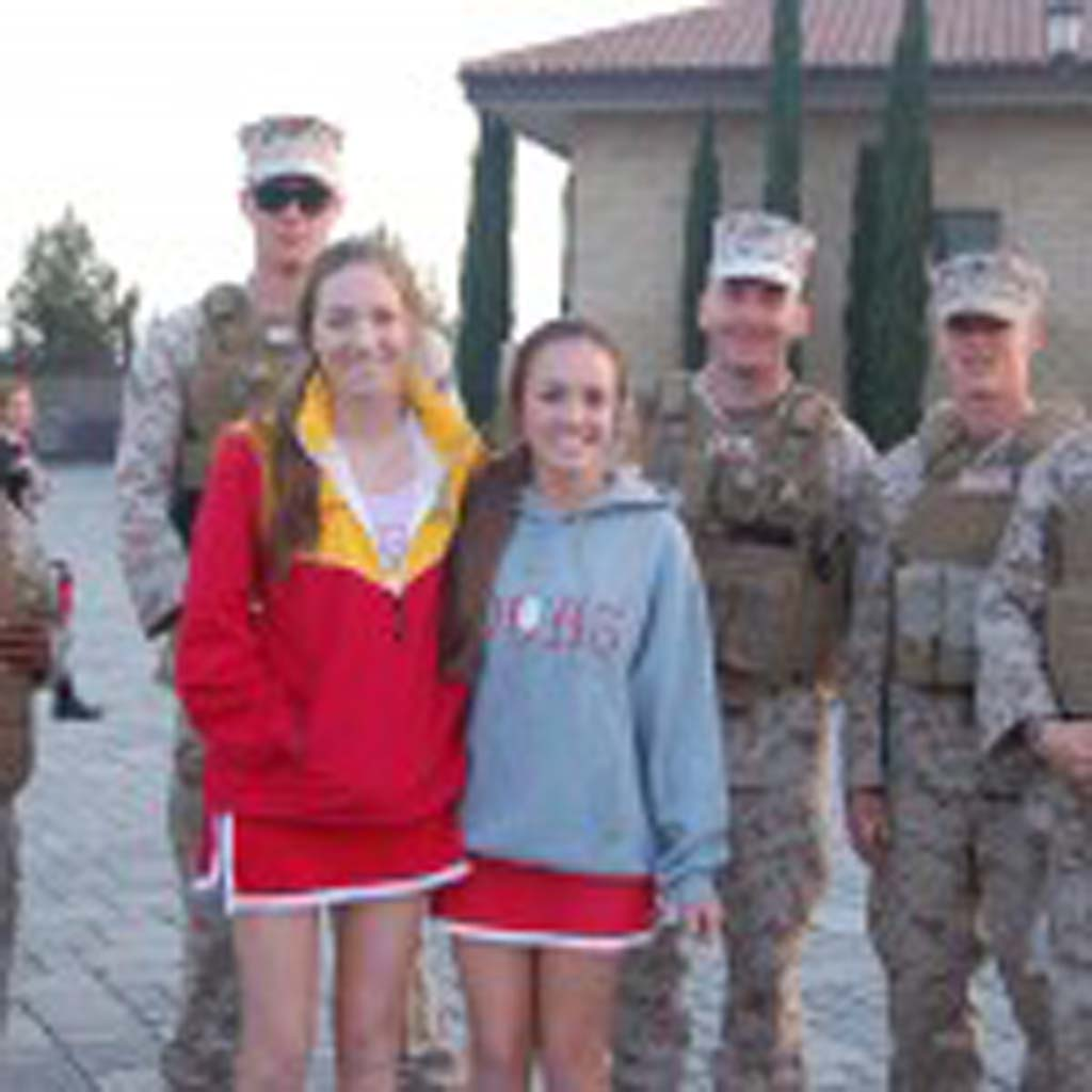 Cathedral Catholic seniors Roisin Gargan and Ali Bentin pose with U.S. Marines. Photo by Bianca Kaplanek