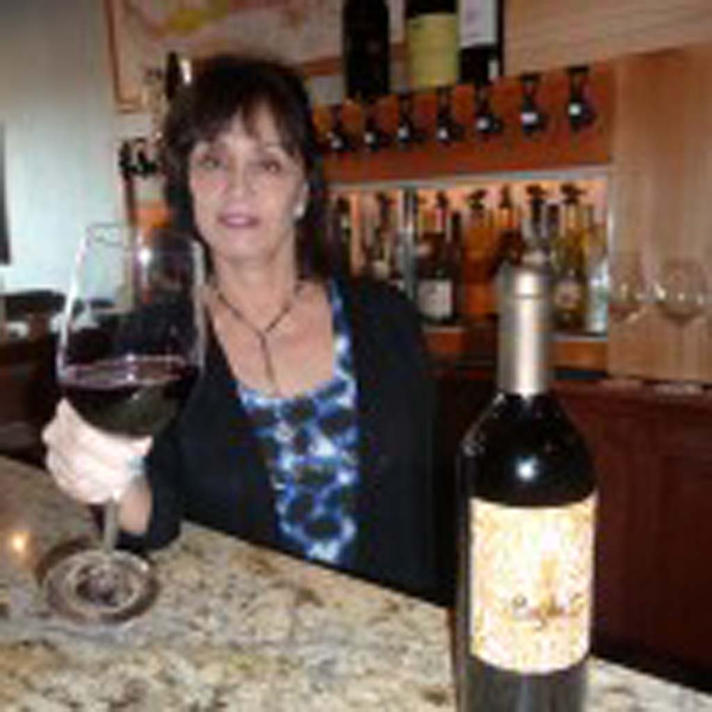 Ellena Cassidy is the friendly wine hostess behind the bar at Encinitas Wine Merchants. Here she serves up a Paso Robles Pay Dirt blend.