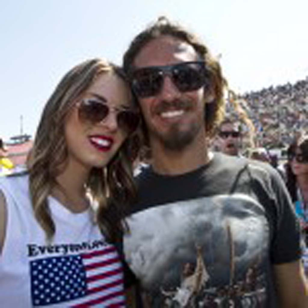 Cardiff residents Rob Machado and his girlfriend, Sophie Vilardo hang out in the pits before the race. Photo by Daniel Knighton