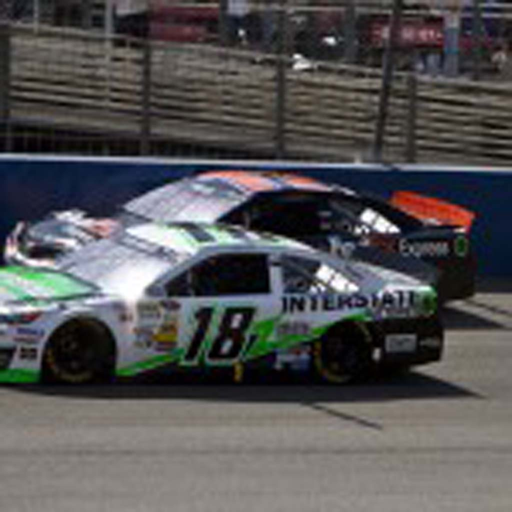 Kyle Busch (18) passes Denny Hamlin (11) early in the race, but the two were still battling it out until the final lap. Photo by Daniel Knighton