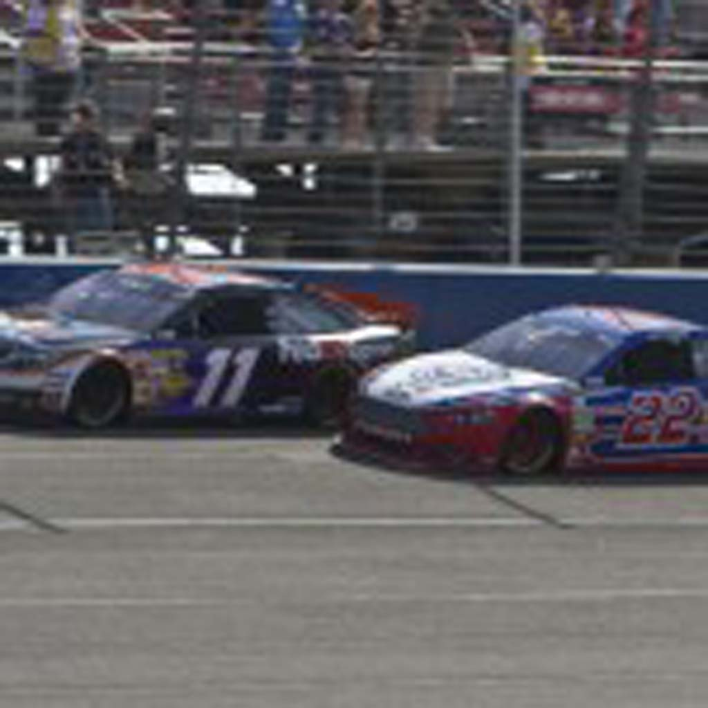 Denny Hamlin (11) and Joey Logano (22) go head-to head just prior to their collision between turns 3 and 4 that sent Hamlin to the hospital. Photo by Daniel Knighton