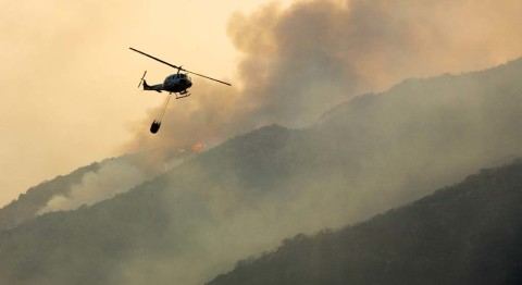 Fire fee collection halted, heated opposition continues