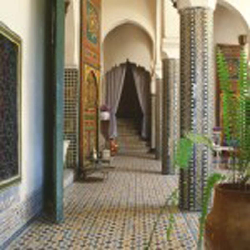 "The atrium of 5,000-square-foot Dar Zitoun (Arabic for ""House of the Olive Tree), the Morse family home, showcases zillij mosaics, quintessential Moroccan terra cotta tile made of enamel chips set in plaster. [Photo by Owen Morse]"