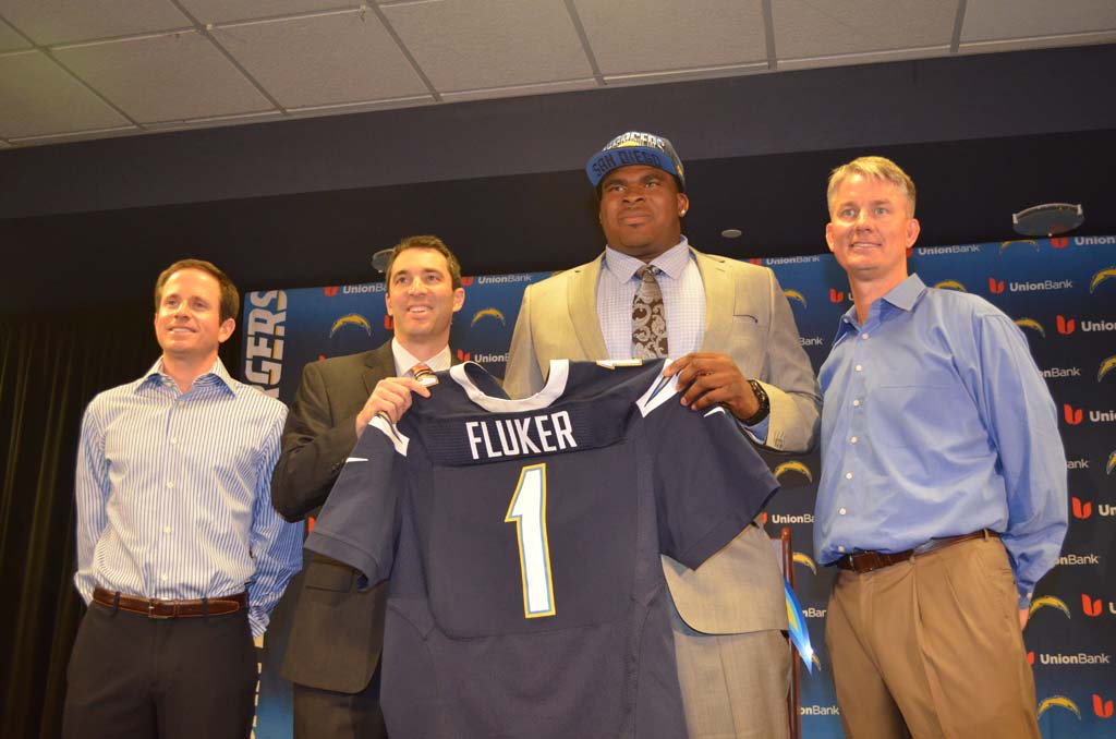 From left: Chargers Executive Vice President Michael Spanos, General Manager Tom Telesco, D.J. Fluker and Head Coach Mike McCoy. Fluker was the team's first round pick in the 2013 NFL draft on Thursday. Photo by Tony Cagala