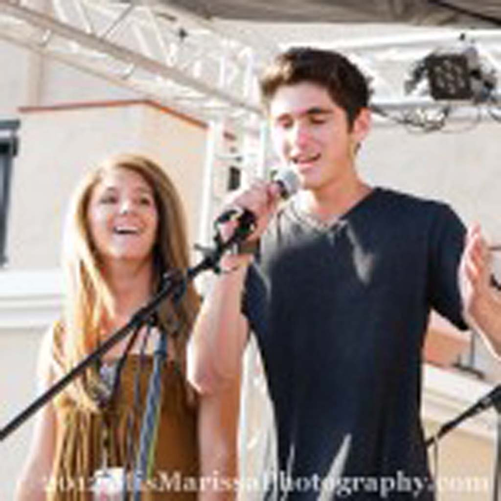 Noah and Jenna Lizerbram, La Costa Canyon students and founders of YouthJamz, introduce the next act at last year's fundraiser concert. Courtesy photo