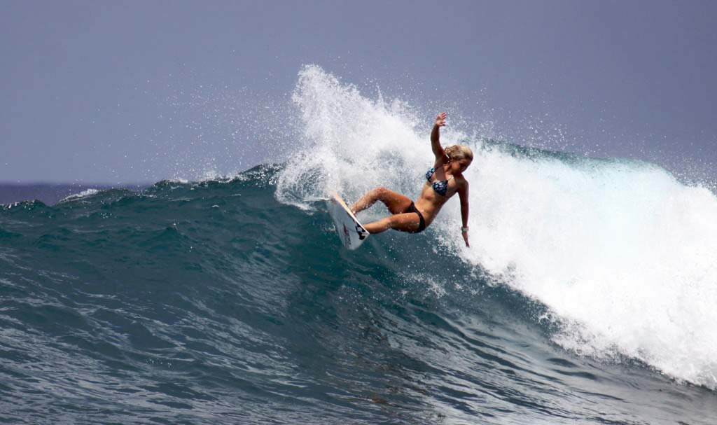Kenzie Kessler surfs off of the coast of one of the Mentawai Islands in Indonesia. Photo by Geni Larosa