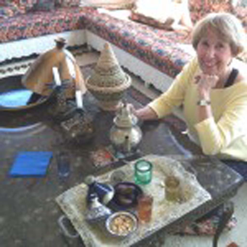 "Kitty Morse, author of ""Mint Tea and Minarets,"" serves tea in her long-time, Moroccan-style Vista home. She has written extensively about life and the cuisine of her native Morocco. [Photo by E'Louise Ondash]"