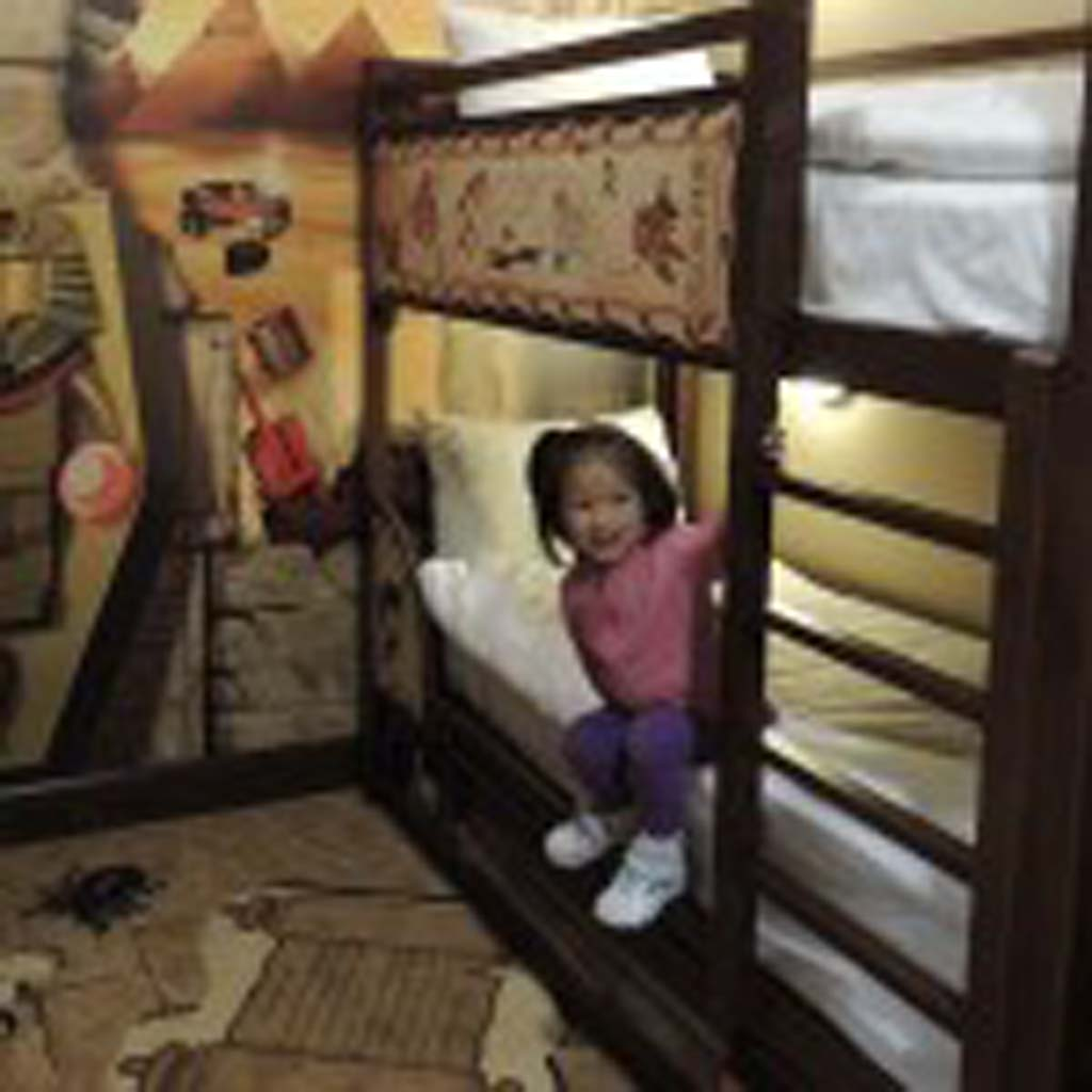 A little girl tested out the bunk beds in one of the adventure-themed rooms in the hotel. Photo by Rachel Stine