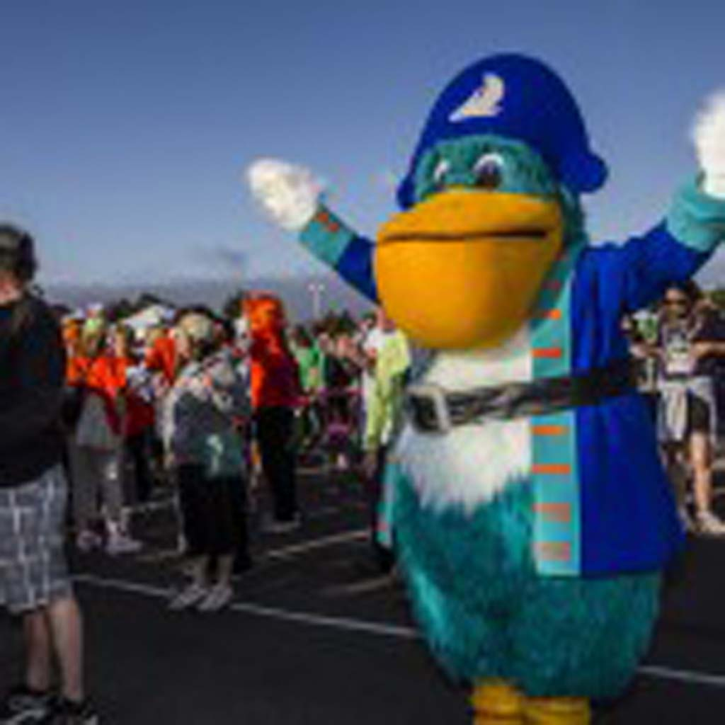 """Captain Bill,"" the San Diego County Credit Union mascot helps lead morning calisthenics before the MS Walk begins. Photo by Daniel Knighton"