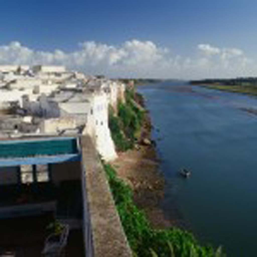 The Oum er-Riba (Mother of Spring River) flows past the terrace of Dar Zitoun (lower left), the Morse family home in Azemmour, Morocco, near Casablanca. It took Vistan Kitty Morse more than 15 years to breach the Moroccan bureaucracy and gain title of the historic home.  [Photo by Owen Morse]