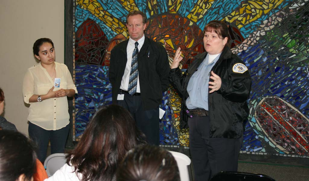 (Left to right) Divina Hernandez, of neighborhood services, Oceanside Police Captain Ray Bechler and officer Dolce Fish update residents on recent arrest related to the March 13 shooting. Suspects arrested are Martin Melendrez of Vista, Michael Zarita of Vista and Santo Diaz of Oceanside. Photo by Promise Yee
