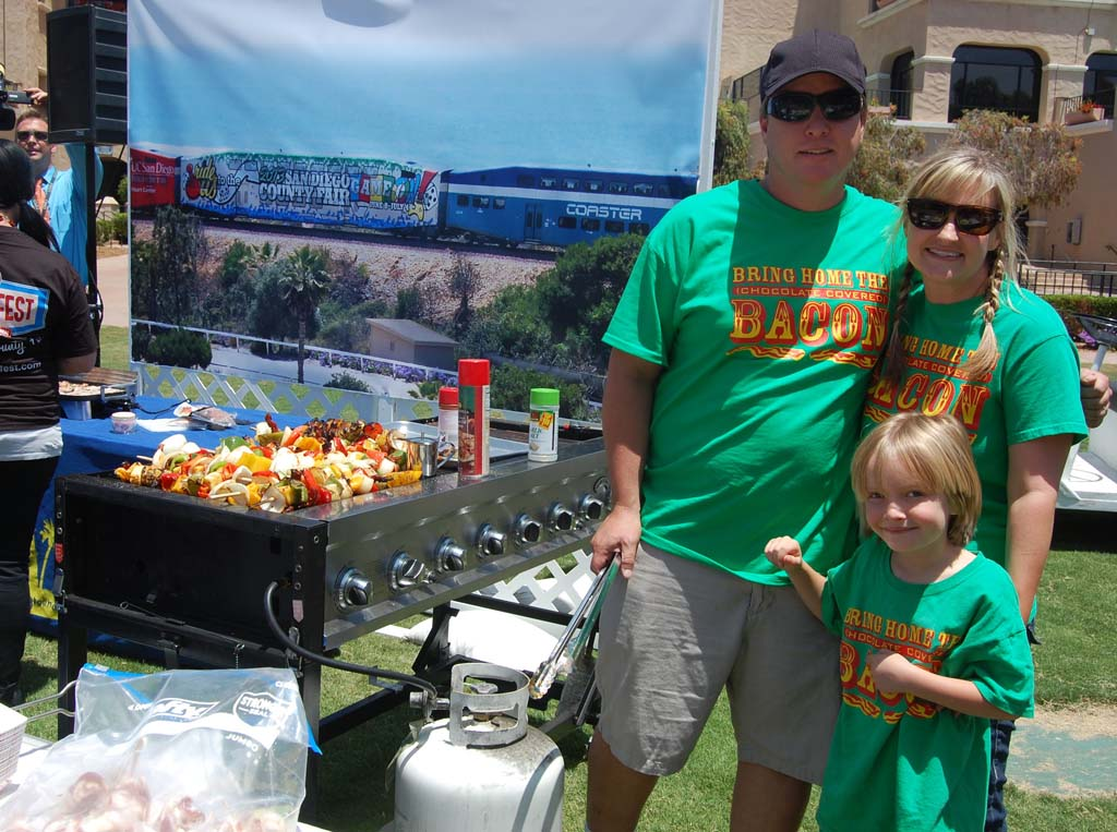 Mike, Brittany and John Peterson grill up some wild boar and bacon kabobs. Photo by Bianca Kaplanek