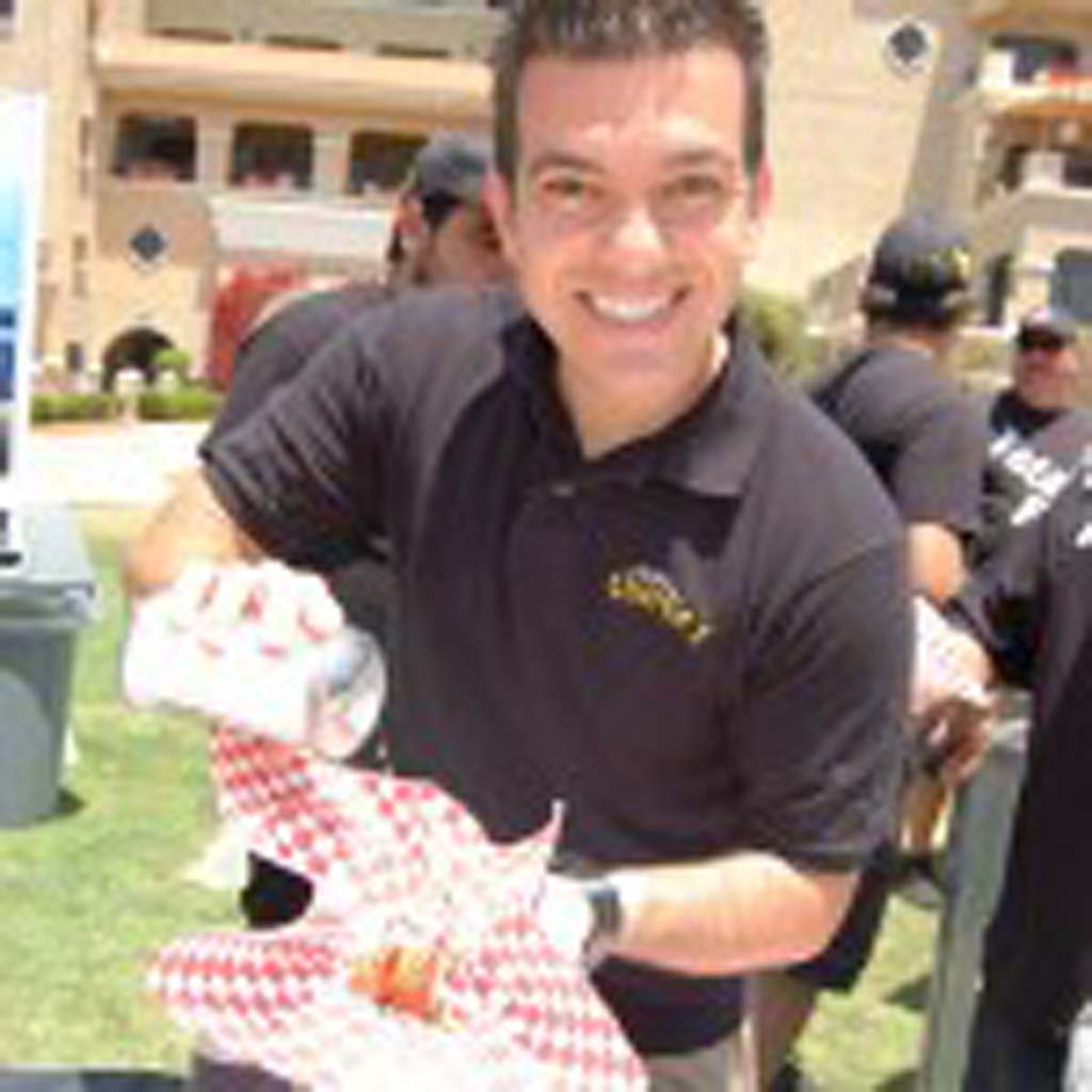 Tony Boghosian puts the finishing touch on the deep-fried cookie dough from Chicken Charlie's. Photo by Bianca Kaplanek