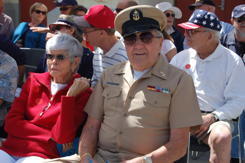 Retired Navy Chief Rob Cook and his wife of 61 years, Clarie, wait for the ceremony to begin. Photo by Bianca Kaplanek