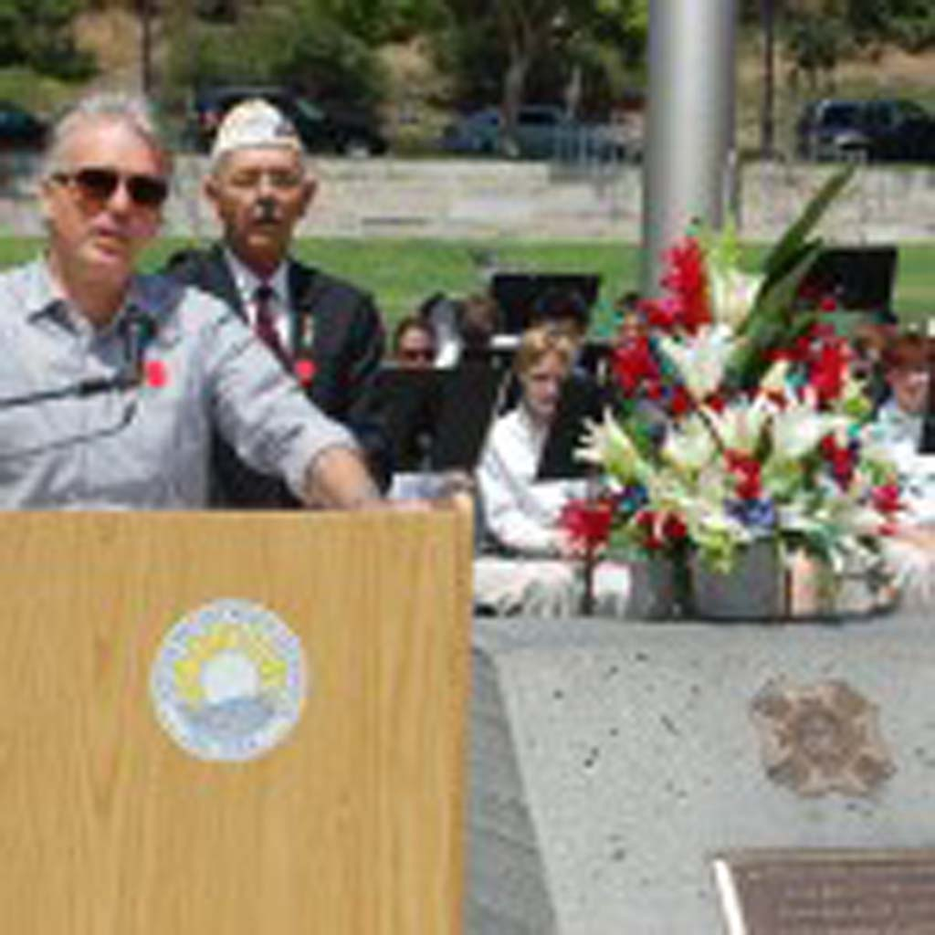 Guest speaker David Jacinto shares a story about Gen. James Doolittle, a fighter pilot who led an attack on Japan that became known as The Doolittle Raid. Looking on is Randy Treadway, VFW Post 5431 commander. Photo by Bianca Kaplanek